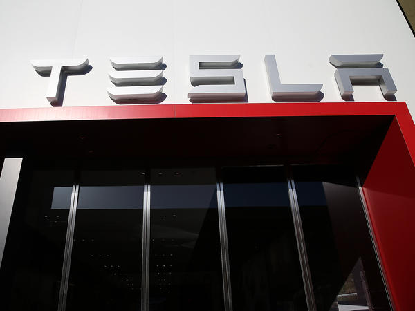A Tesla showroom in California. The company announced production of its long-awaited mass-market Model 3 car will begin Friday.