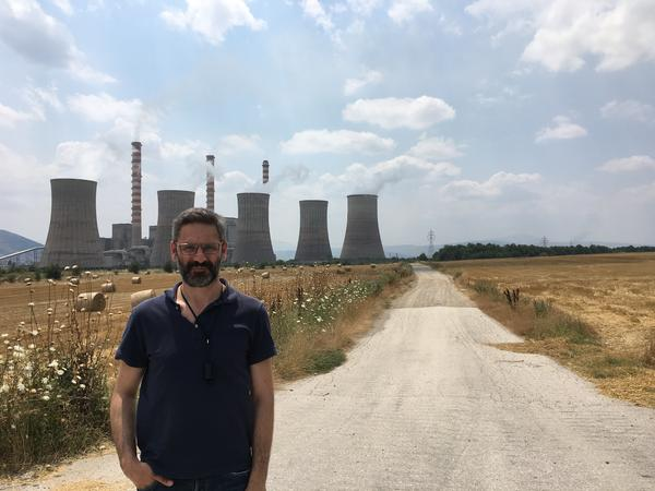 Kozani Mayor Lefteris Ioannidis stands in front of the Agios Dimitrios coal plant, one of the most polluting in Europe. A longtime environmentalists, he's trying to convince the Greek government to retrain coal workers for jobs in the renewable industry, like assembling wind turbines or solar panels.