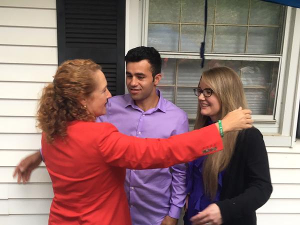 U.S. Rep. Elizabeth Esty, D-CT5, embraces Joel and Samantha Colindres on Monday. Joel, a native Guatemalan who is married to Samantha, a U.S. citizen, and father two their two U.S.-born children, has been ordered to leave the country by August 17.