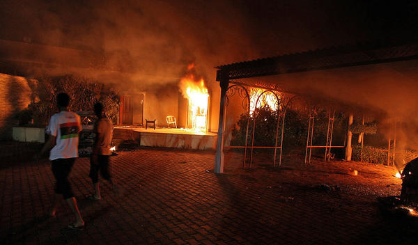 A vehicle and surrounding buildings burn after an attack inside the U.S. consulate compound in Benghazi, Libya, on Sept. 11, 2012.