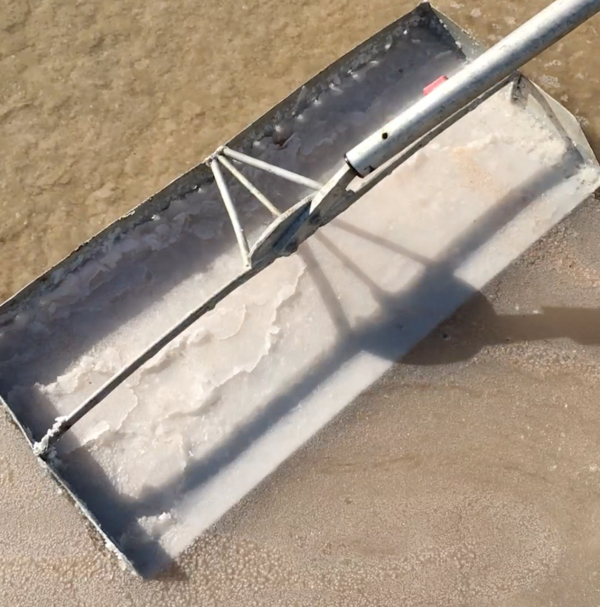 <em>Fleur de sel</em> is skimmed with a special tool called a <em>lousse</em>.