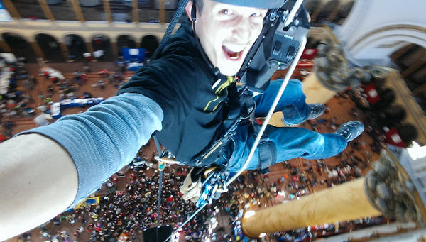 Nate Ball takes a selfie from 120 feet in the air at the top of the National Building Museum in Washington, D.C.