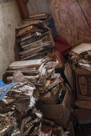 <p>Documents gather dust in decaying boxes in Carol Van Strum's shed in the Siuslaw National Forest. For decades, Van Strum has been amassing documents about the chemical industry through lawsuits and Freedom of Information Act requests.</p>