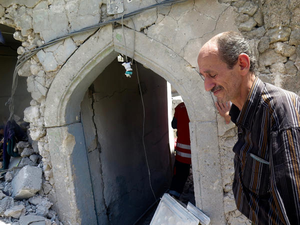 Bashar Abdul Jabar lost his 15-year-old son, Ahmed, when part of their house collapsed during fighting between Iraqi troops and ISIS. He returned to the city to retrieve his boy's body with the help of civil defense forces.