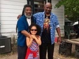 Wadada poses with his granddaughter, Jaya, and a distant cousin he met for the first time on the street in Leland, Miss.
