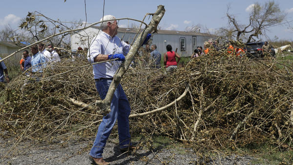 Vice President Pence helps clear brush during a visit to Texas on Thursday.