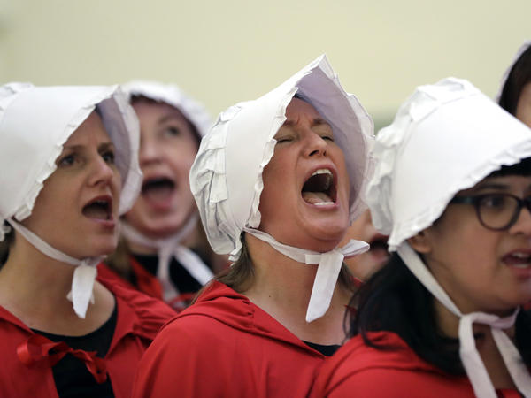 Demonstrators dressed as characters from <em>The Handmaid's Tale</em> at the Texas Capitol in May 2017 to protest SB8, a bill restricting abortions and fetal tissue donations.