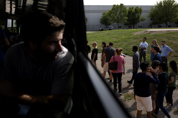 First-year Washington University medical school students board a school bus after a stop on a trip around St. Louis in August.