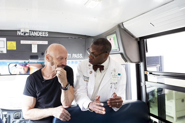 Professor Bob Hansman and Dr. Will Ross speak before the start of the bus tour.