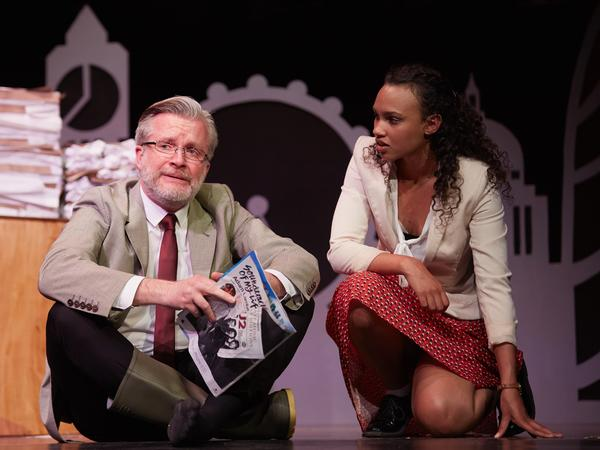 In another scene, Labor Party leader Jeremy Corbyn (Andy Watkins) is consoled by his researcher (Michaela Bennison) because he'll miss out on Glastonbury Festival because of the turmoil over Brexit.