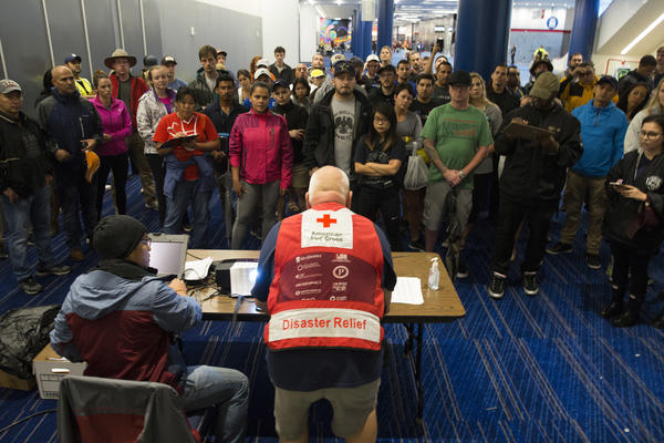 Volunteers get a briefing on Thursday at the George Brown Convention Center that has been turned into a shelter run by the American Red Cross to house victims of the high water from Hurricane Harvey in Houston, Texas.