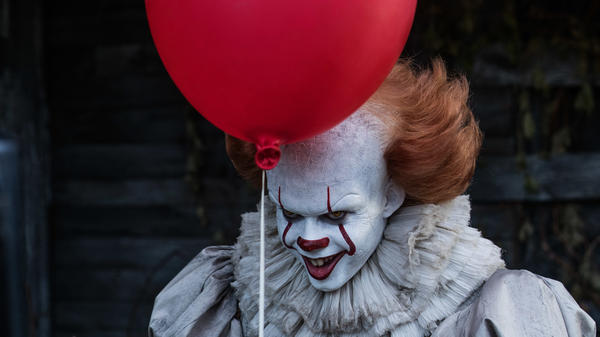 One <em>luftballon</em> down, 98 to go: Bill Skarsgård stars as Pennywise in director Andy Muschietti's horror thriller <em>It</em>.