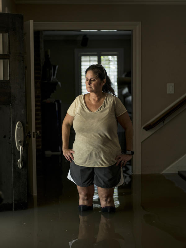 Jennifer McKnight was flooded out in New Orleans during Hurricane Katrina. Her Houston home was still filled with about 2 to 3 feet of water on Thursday.
