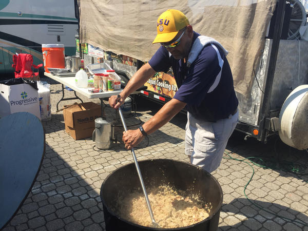 Volunteer Mike Hall stirs a batch of jambalaya in a gas-fired kettle.