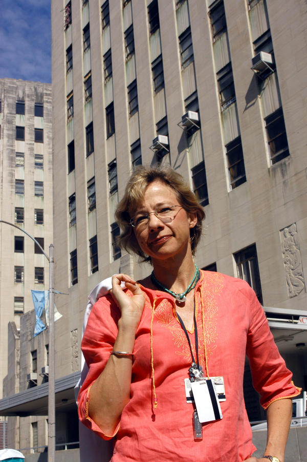 Dr. Ruth Berggren stands outside Charity Hospital in New Orleans in 2005, where she had earlier cared for patients during Hurricane Katrina.