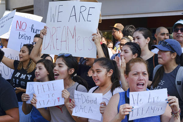 Supporters of the Deferred Action for Childhood Arrivals, or DACA chant slogans and holds signs while joining a Labor Day rally in downtown Los Angeles on Monday, Sept. 4. (Richard Vogel/AP)
