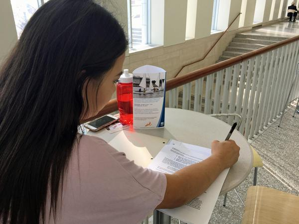 Nineteen-year-old Paola has lived most of her life in the U.S. after being brought from El Salvador by her mother when she was a child. She received deferred action in 2016 and Tuesday was her first day of classes at UMass Boston. She said she spent much of the day wondering just how long her college experience might last. (Jesse Costa/WBUR)