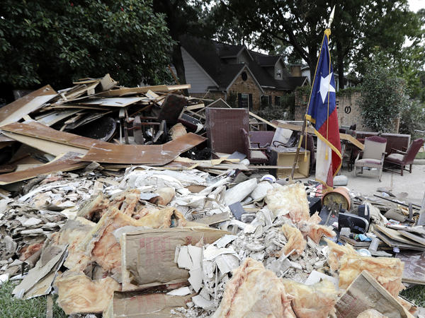 A pile of debris sits outside a business damaged by floodwaters in the aftermath of Hurricane Harvey on Sept. 5 in Spring, Texas.