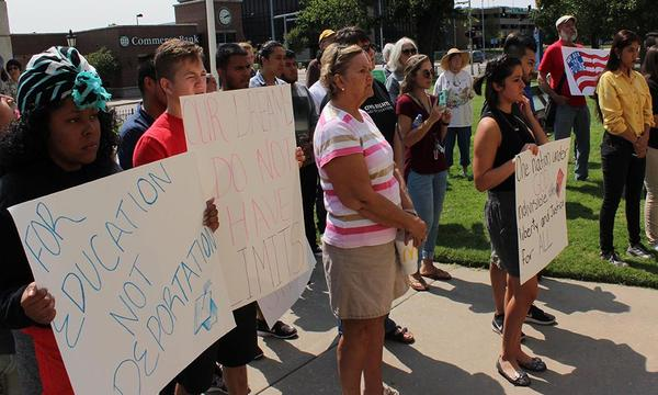 A crowd of DACA supporters gather at the steps of the Sedgwick County Courthouse Tuesday.