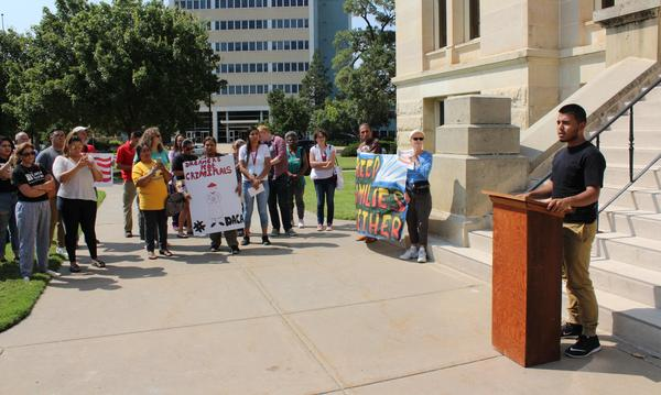 Tony Ibarra, 19, shares his story of receiving protection under DACA to a crowd at the Sedgwick County Courthouse.