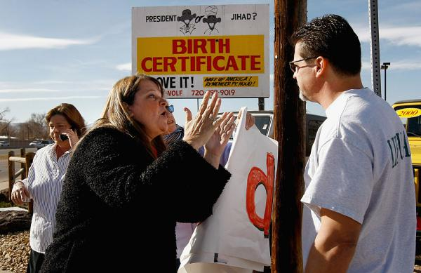 "The book ""Fantasyland"" lays out the long history that has led to fringe political conspiracy theories like birtherism, seen on display in the billboard pictured here, in Colorado. In this 2009 photo, Obama supporter Mary Schaeffer argues with Obama critic Gary Henderson in front of the controversial sign."