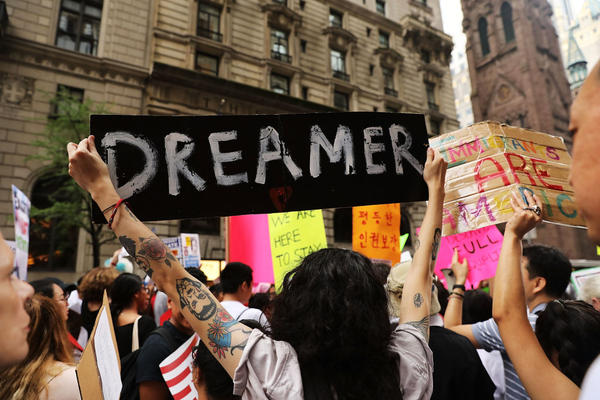 Dozens of immigration advocates and supporters attend a rally outside of  Trump Tower on August 15. Now, more than 400 companies have joined in seeking to preserve the protections of DACA.