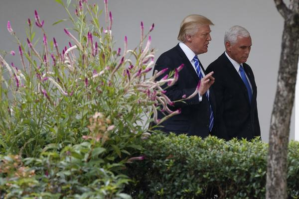 President Donald Trump walks with Vice President Mike Pence after a meeting with Congressional leaders in the Oval Office of the White House, Wednesday, Sept. 6, 2017, in Washington. (Evan Vucci/AP)