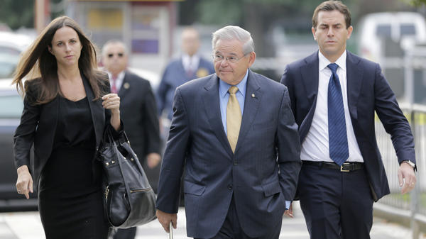 Sen. Bob Menendez (center) arrives with his children to court in Newark on Wednesday.