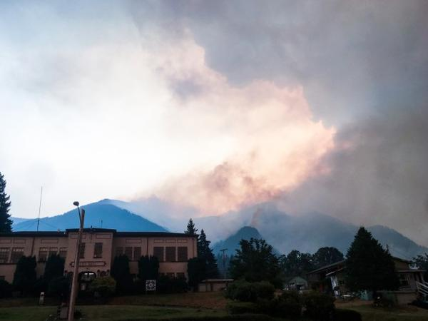 <p>The Eagle Creek Fire is seen burning behind the Cascade Locks City Hall Monday, Sept. 4, 2017. </p>