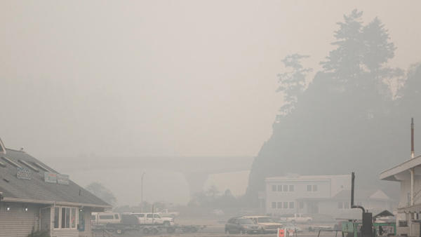 <p>Smoke from Chetco Bar Fire obscures view of Highway 101 from Brookings Harbor.</p>