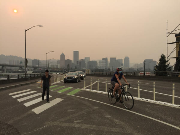 <p>Smoke from the Eagle Creek wildfire darkens the skies in downtown Portland.</p>