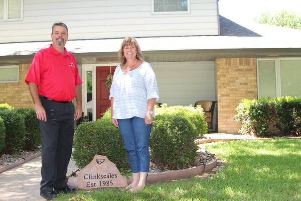 Steve and DeEdra Clinkscales in front of their home in Cleburne, Texas.