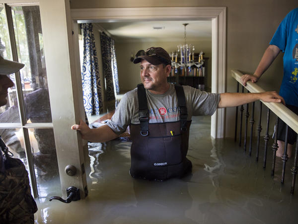 Ray Blanchette stands in his flooded home in the Nottingham Forrest subdivision of Houston on Aug. 31.