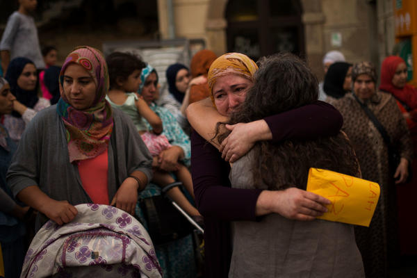 Members of the local Muslim community gather along with relatives of young men believed responsible for the attacks in Barcelona and Cambrils to denounce terrorism in Ripoll, Spain, on Aug. 20.