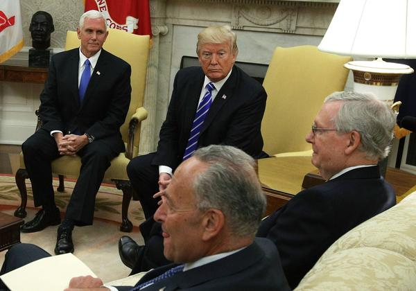 Clockwise from upper left, Vice President Pence and President Trump meet with Senate Majority Leader Mitch McConnell (R-Ky.), Senate Minority Leader Chuck Schumer (D-N.Y.) and other congressional leaders in the Oval Office of the White House Sept. 6, 2017 in Washington, D.C. (Alex Wong/Getty Images)