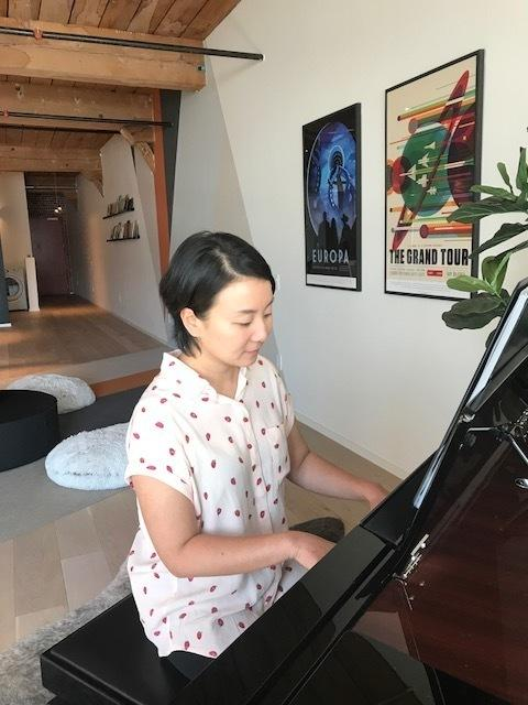 Lu plays the piano in her loft in downtown LA. She's currently working on a book about Mozart's sister, Maria Anna.