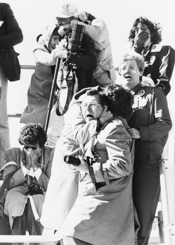 Spectators' faces register horror, shock and sadness after witnessing the explosion of the space shuttle Challenger 73 seconds after liftoff on Jan. 28, 1986.