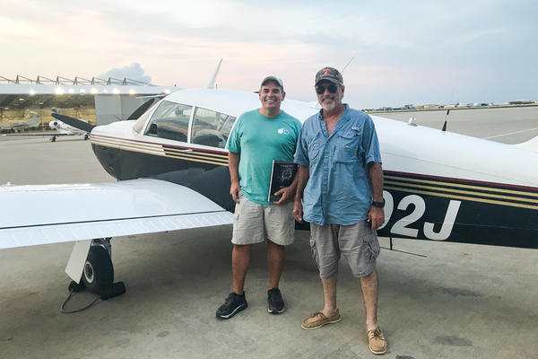 "Pilots Andy Cook (left) and Rocky Breaux flew in from Houma, La. with diapers, toys, games, books and strollers packed. They were part of the ad hoc ""Cajun Airlift."""