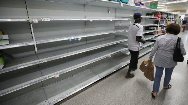 Shelves that once held bottled water are empty as Miami prepares for the approaching Hurricane Irma.
