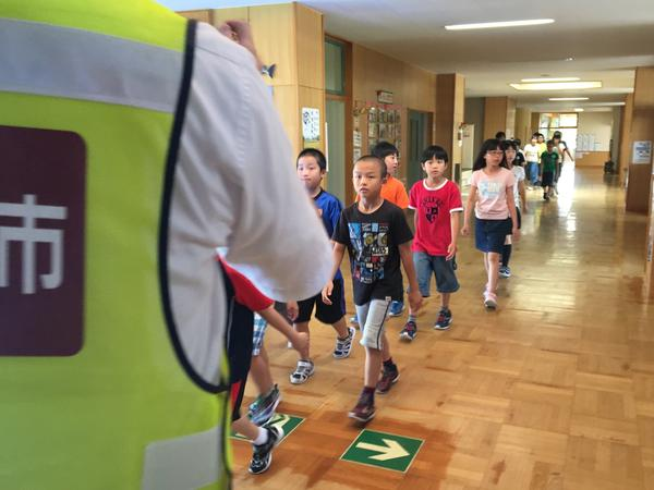 Elementary school students in Iwamizawa, a town in Japan's Hokkaido prefecture, take part in a missile drill.