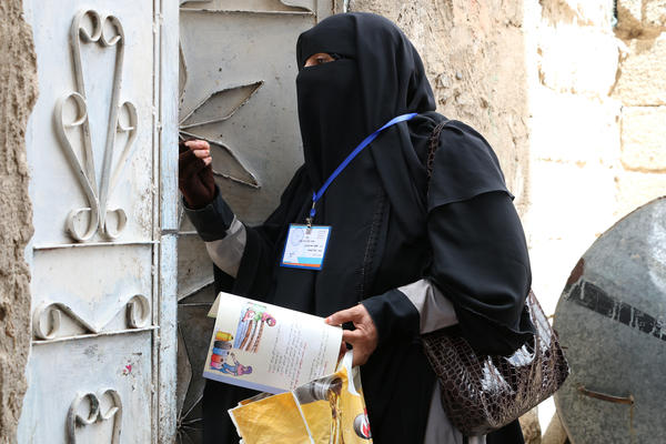 Faytha Ahmed Farj, a mother of nine, goes door-to-door in Sanaa, Yemen, to tell people how to avoid cholera — and what to do if they see symptoms.