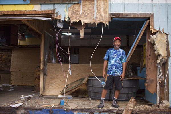 Long Nguyen stands inside what is left of the Fulton Harbor Bait Stand in Fulton, Texas. Nguyen came to the region as a 12-year-old boy in 1975 with his family from An Thoi Kouc, Vietnam. A year after his family arrived they collectively bought a shrimp boat.