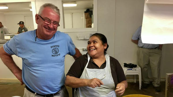 Harry Phillips with master picker Elpidia Martinez, one of 600 Mexican seasonal migrant workers, mostly women, who get H-2B visas to work in Maryland. The state's seafood industry says each worker supports 2.5 American jobs. (Armando Trull/WAMU)