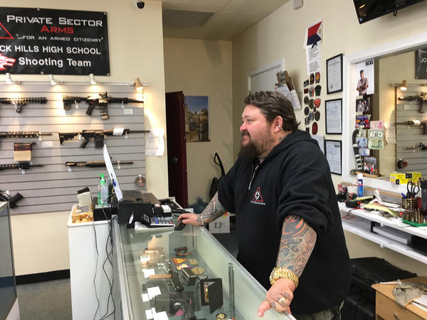 Gun dealer Don Teague behind the counter at his gun store in west Olympia.