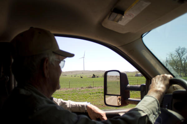A landowner drives by a turbine on his ranch in western Oklahoma.