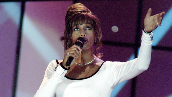 Whitney Houston (shown here performing in 1994) starred in the movie <em>Waiting To Exhale</em>, and contributed several songs to its breathtaking, beloved soundtrack.