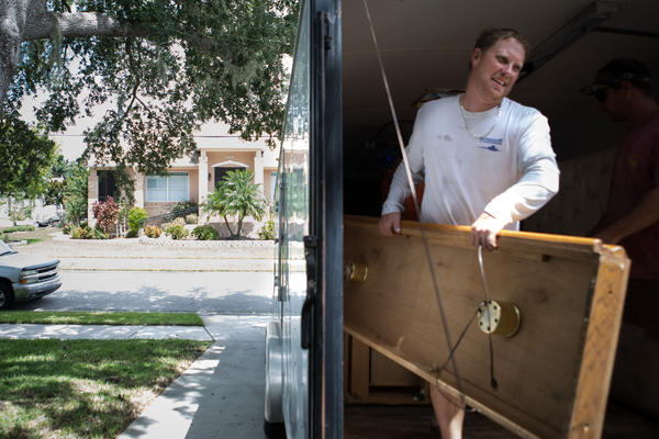 Bobby Huffstutler moves furniture from his late grandmother's home into his parents' house, which sits at a higher elevation.