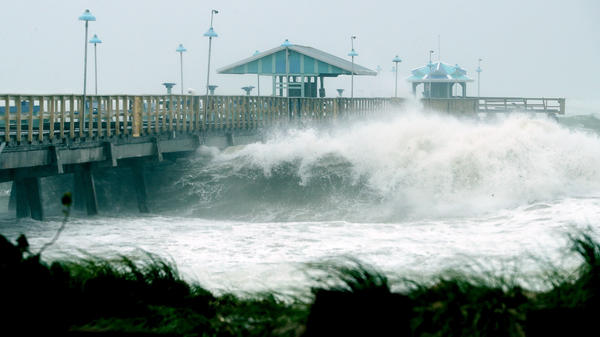 Large waves produced by Hurricane Irma crash into the end of a pier Sunday in Fort Lauderdale, Fla. At the same time this photo was being taken, the hurricane was making landfall in the Florida Keys as a Category 4 storm.