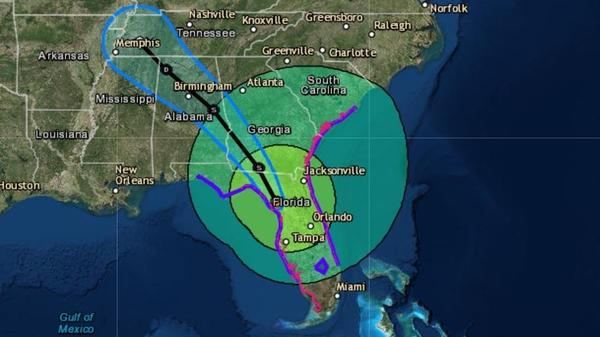 Irma is now a tropical storm — but it still poses severe flooding threats across Florida and into neighboring states. The storm's predicted path is seen here in forecasters' 8 a.m. ET release.