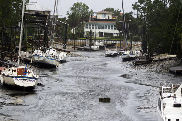 Boats sit on the bottom in the north Florida panhandle community of Shell Point Beach as Hurricane Irma pulls the water out in Crawfordville, Fla.